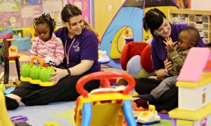 children in nursery with carers